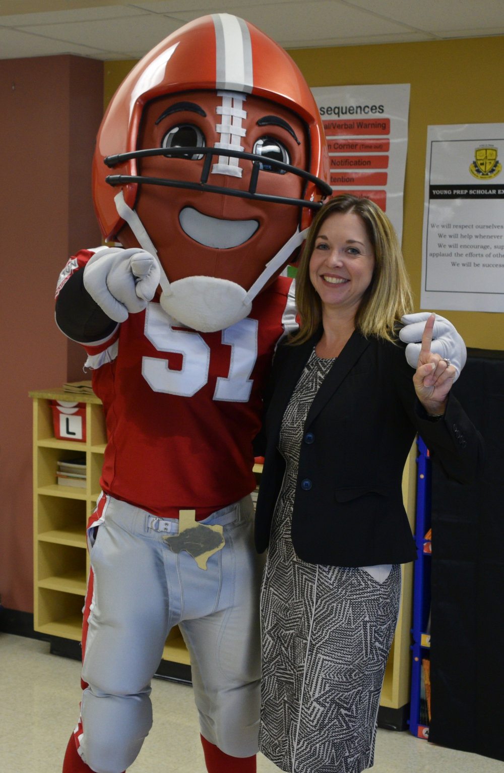 "Super Bowl Host Committee mascot ""TD"" with Foundation President Dr. Julie Baker Finck."