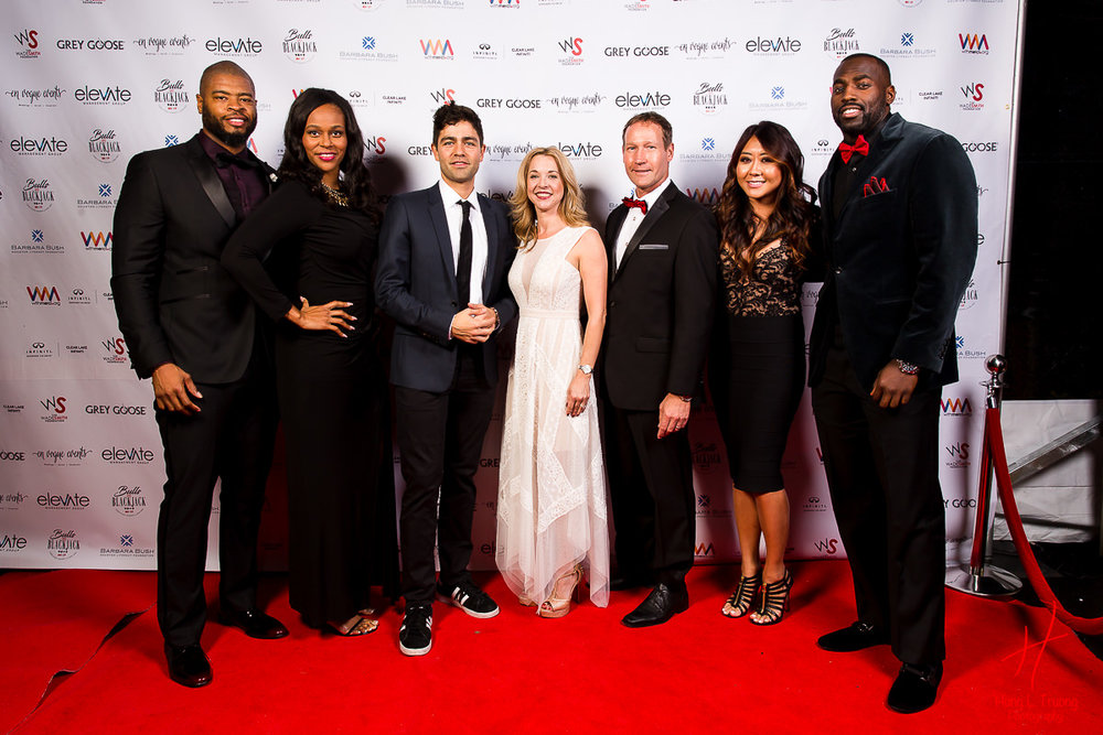 Wade and Rita Smith, Adrian Grenier, Julie and Ron Finck, Maria Ho, and Whitney Mercilus on the red carpet at the Bulls and Blackjack charity event.