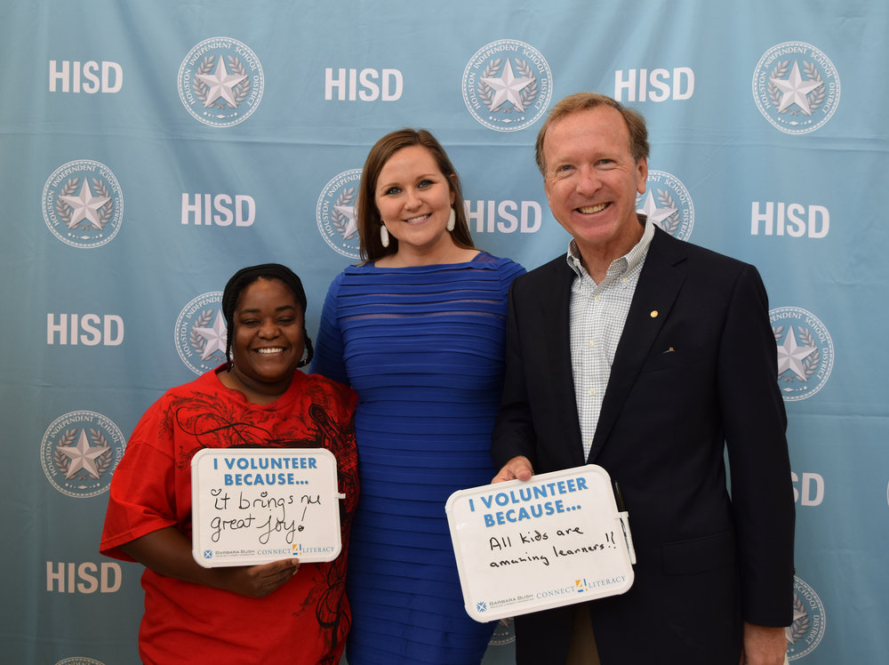 From left: Volunteer mentor stands with Carley Colton, HISD Literacy Specialist, and Neil Bush.