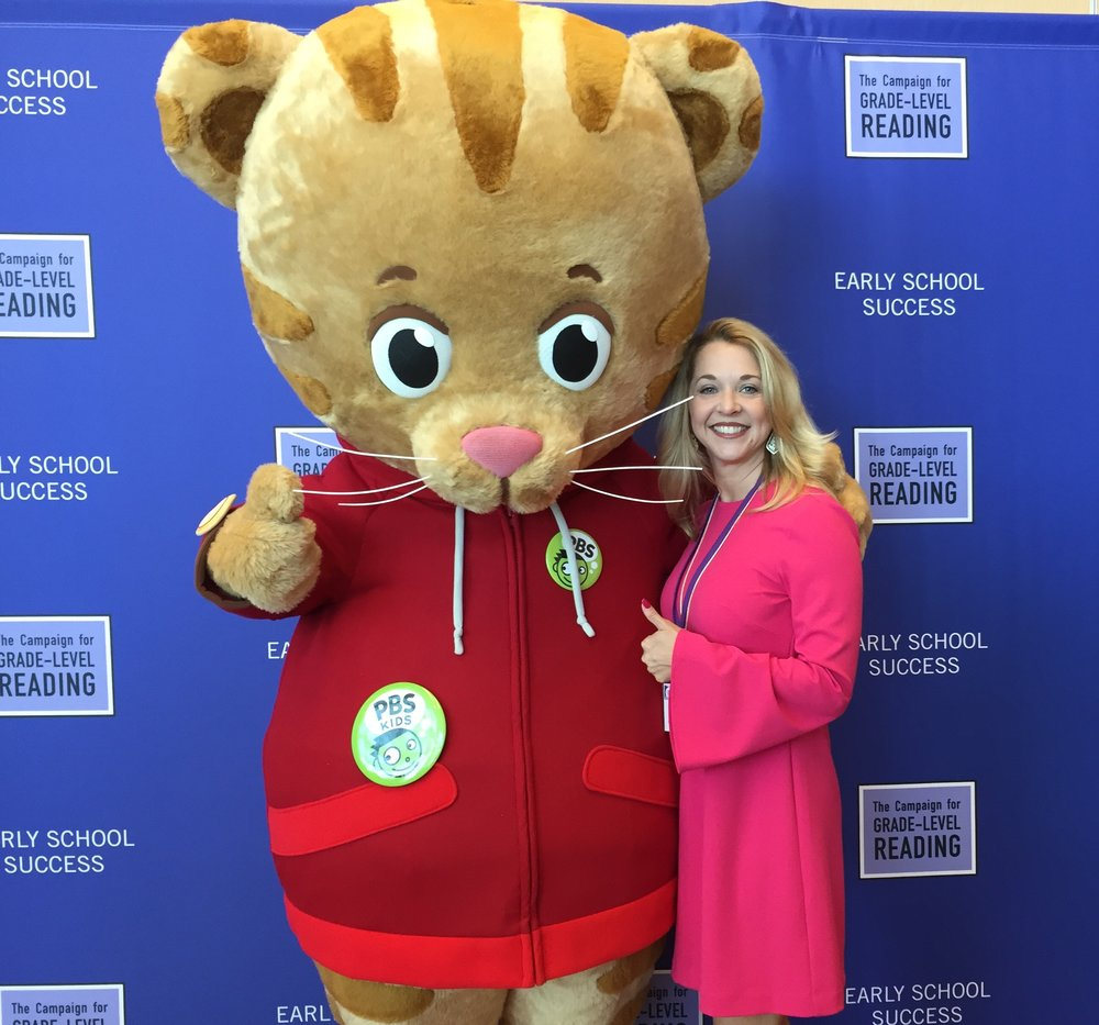 President Julie Finck with Daniel the Tiger, PBS.