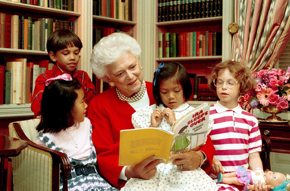 Mrs Bush red sweater pearlsreading.jpg