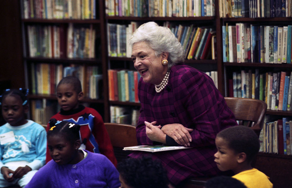 Mrs Bush reading with pearls purple dress.jpg