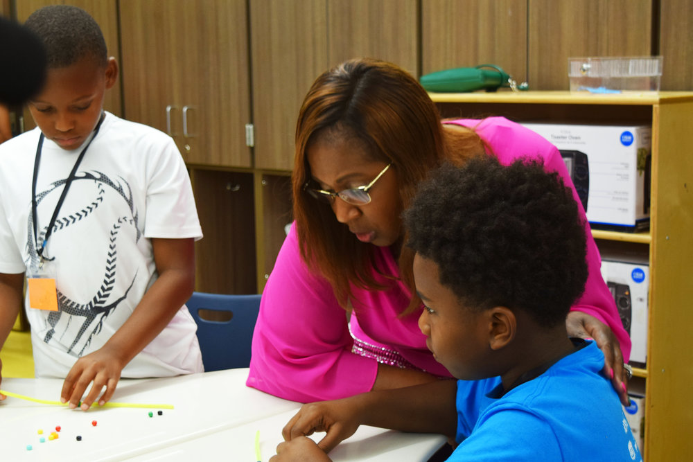 Dr. Grenita Lathan, Interim Superintendent of HISD, talks with student at Camp Adventure!.JPG