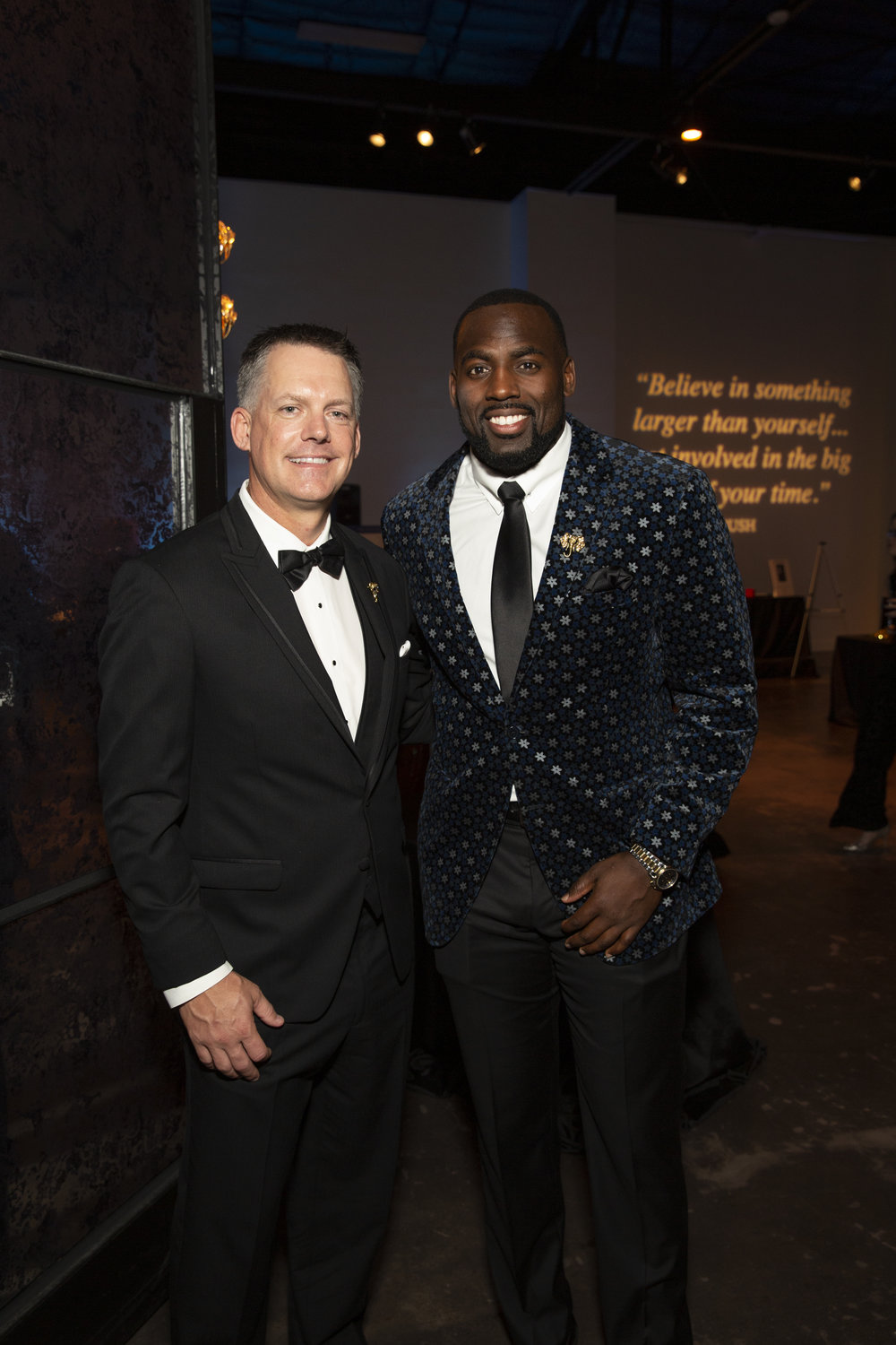 A.J. Hinch, Whitney Mercilus; Photo by Jenny Antill.jpg