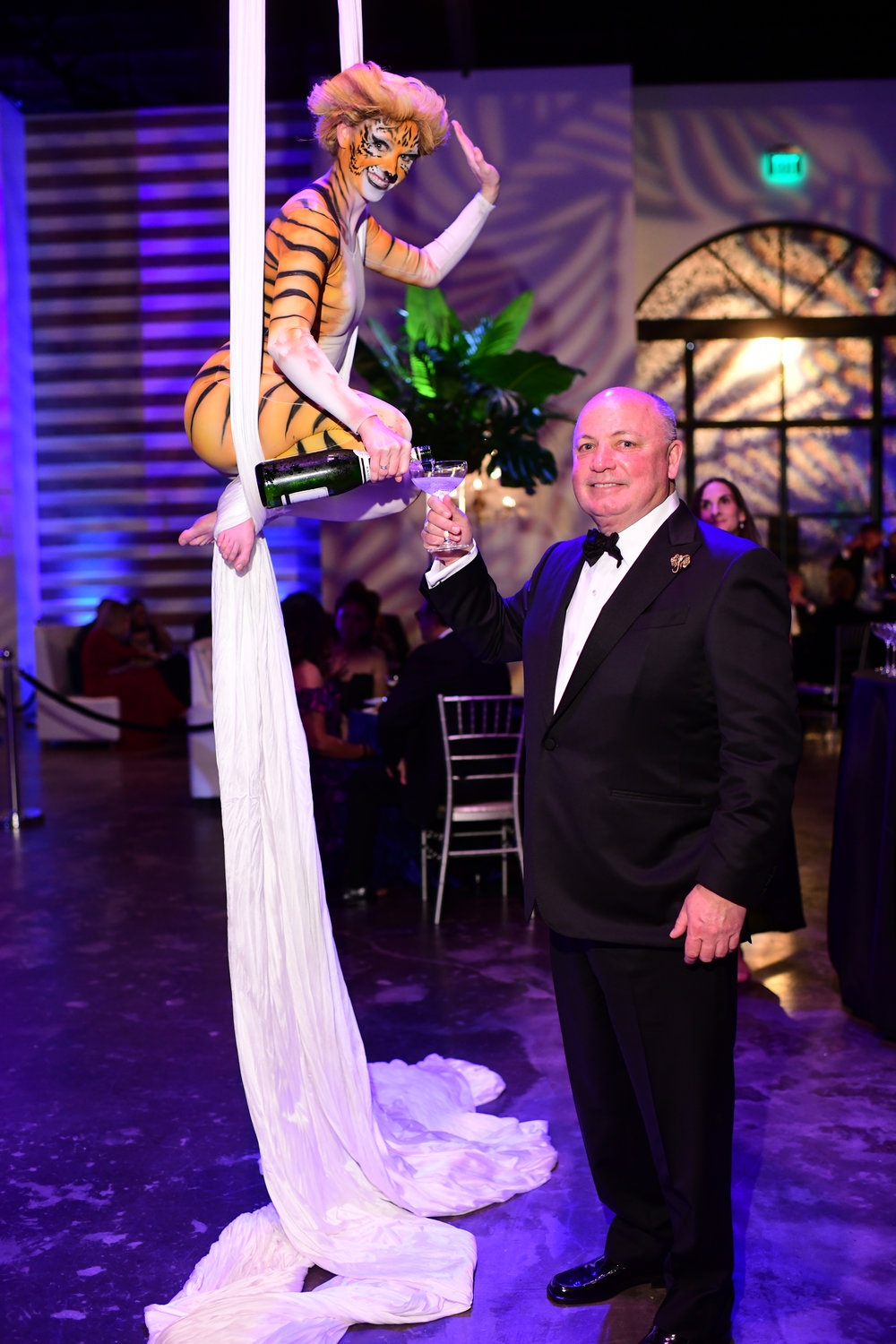 Alan Carnrite getting a glass of champagne; Photo by Daniel Ortiz.jpg