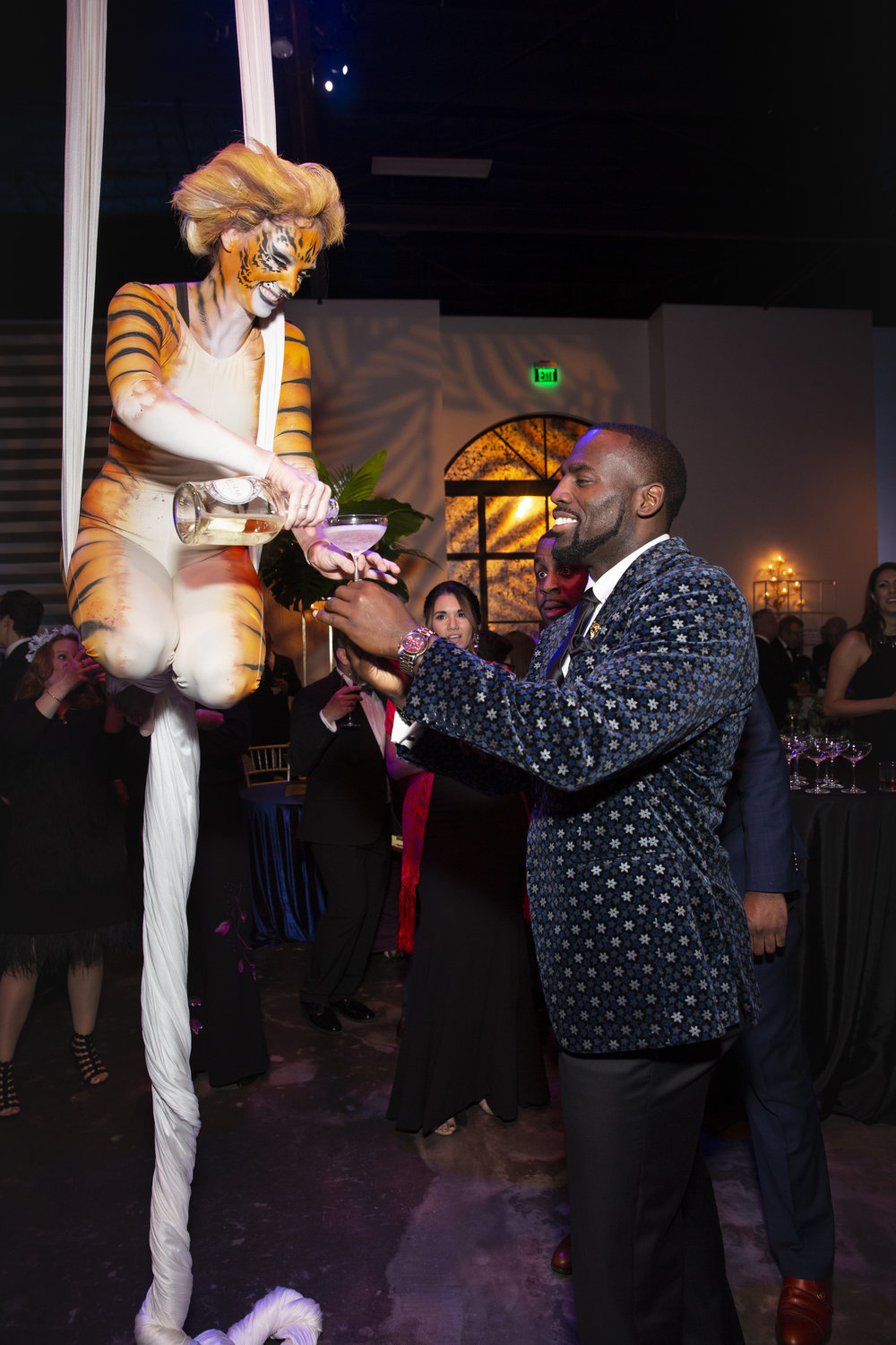Whitney Mercilus getting a glass of champagne; Photo by Jenny Antill.jpg