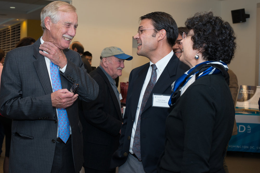 Senator Angus King talks with Dean Jeanne Hey and Associate Dean Charles Tilburg