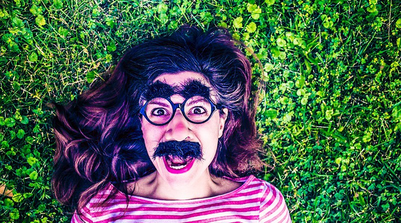grimace-mask-girl-screaming-woman-lying-grass-striped-shirt-mustache-public-domain.jpg