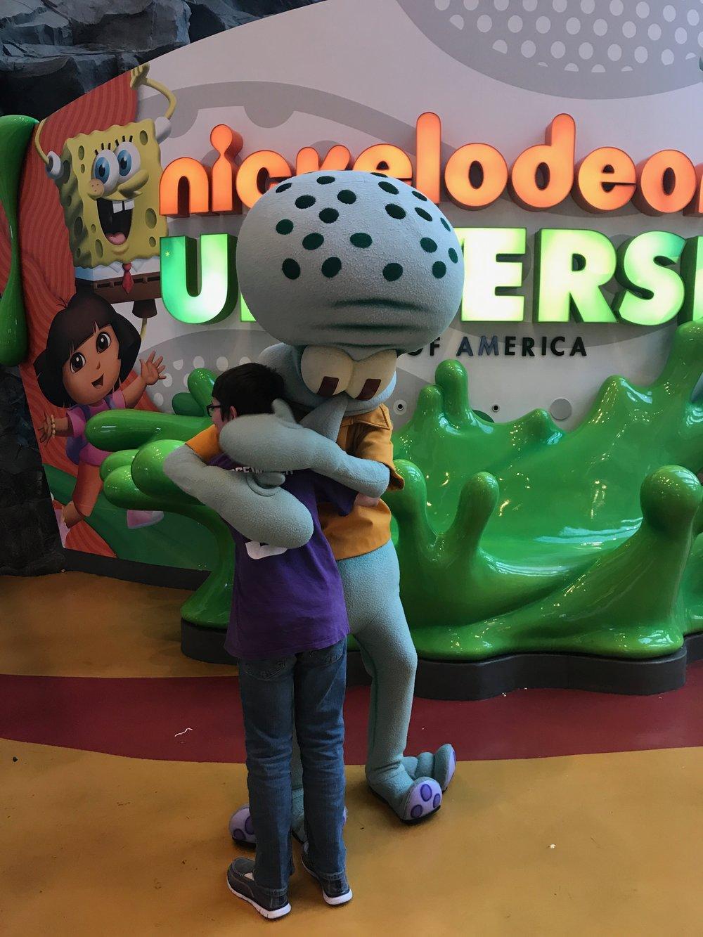 Elijah hugs Squiddy