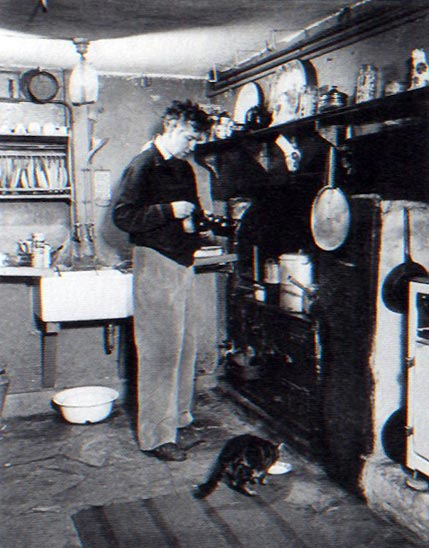 Mixing poetry and domesticity: Robert Graves in his kitchen at Galmpton.