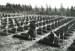 Tending graves at Abbeville, France, 1918