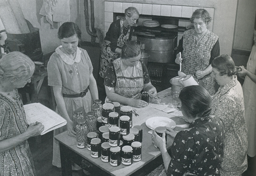 Women's Institute members bottling jams and jellies. The making of preserves exemplified the frugal ethos of the older generation.