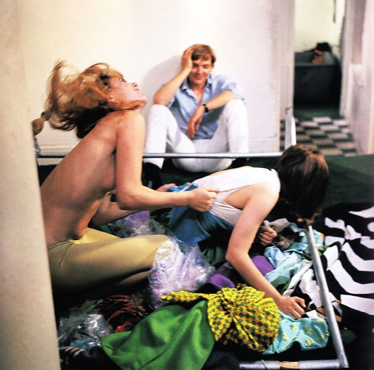 A good angle? David Hemmings observes  the girl-on-girl action in Antonioni's self-conscious movie 'happening', Blow-Up.