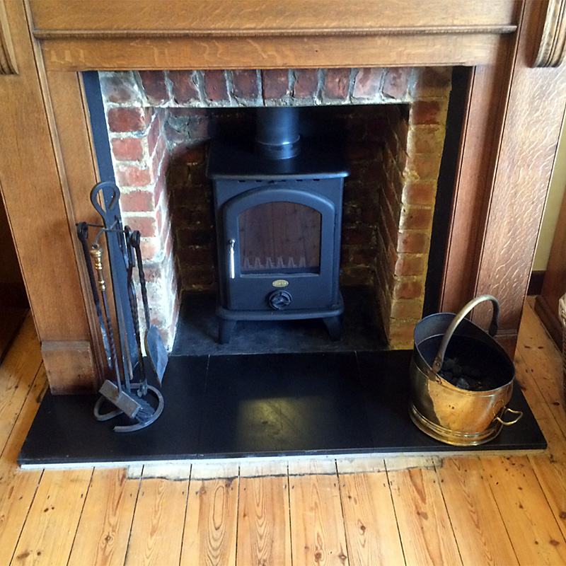 Clark Regal stove installed & slate hearth sanded & polished.