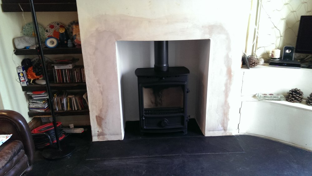 Fdc 5 Wide multi fuel stove installed on a slate hearth in Franklin street, Brighton.