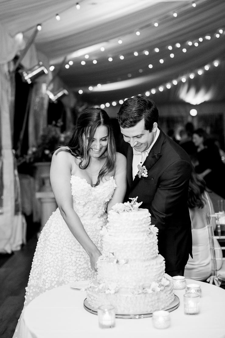 Bride and Groom Cutting the Cake at Gurneys Montauk Wedding Photos