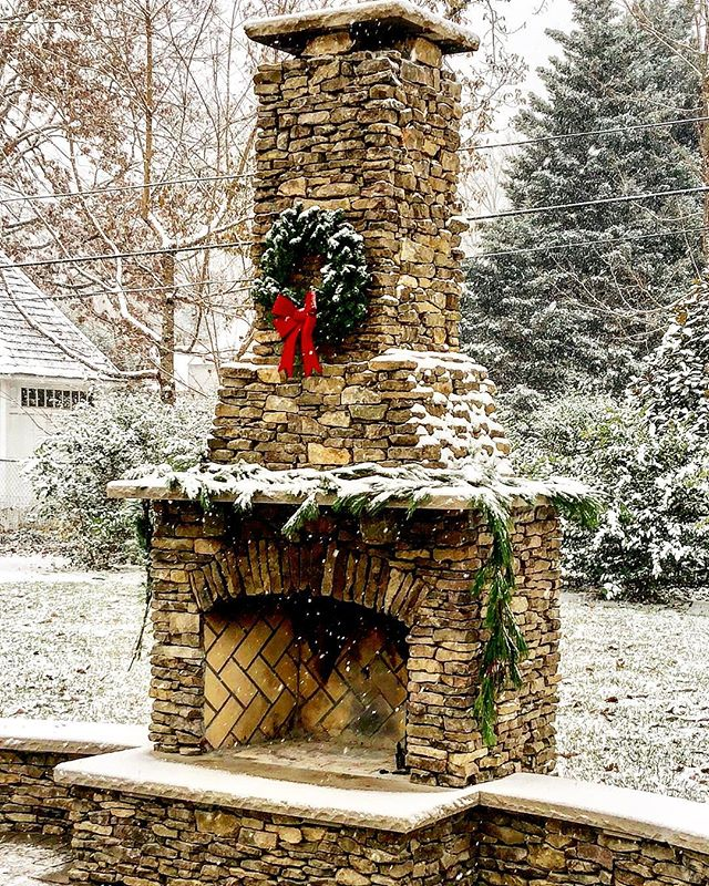 Great shot from a client of our recent snow fall! • • • #fireplace #masonry #veneer #stoneveneer #chimney #snow #snowfall #winter #winterwonderland #wreath #christmas #christmaswreath #hardscape #hardscaper #hardscapes #builder #contractor #contractorsofinsta #design #limestone #herringbone #fire #construction #rva #rvasnow #richmond #henrico #hanover #westend #riverroad