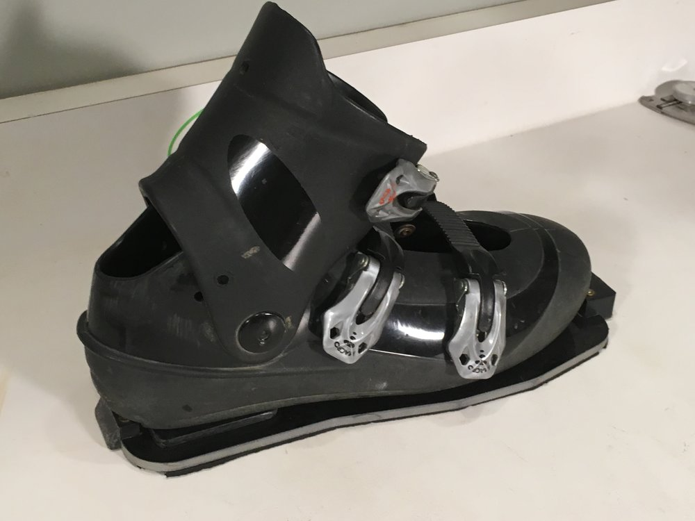 - What I liked about this boot is the lack of heel tongues that restrict forward movement and it has a stiff lower structure but a flexible cuff.