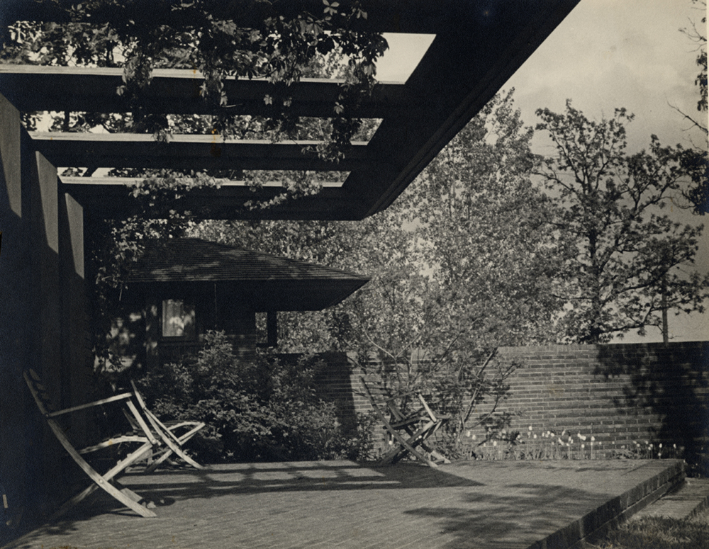 The terrace and garden, circa late 1930s. In the absence of large shade trees, the trellis draped in wisteria vines provided a lush shelter.