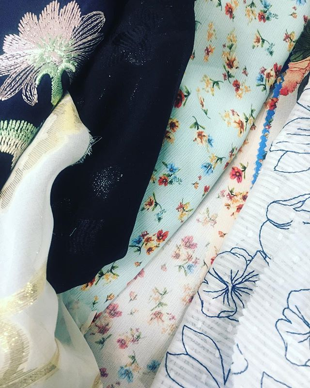 #tbt to when we were planning for our spring line and choosing from tons of amazing fabrics.  Look at all these amazing bright florals - it makes us want spring weather right now! 🌻