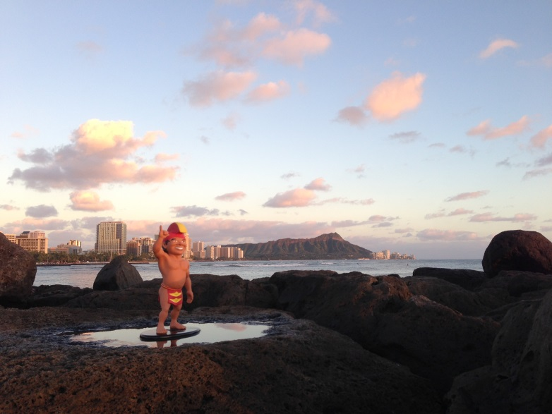 Menehune watching the sunset from Magic Island, Ala Moana