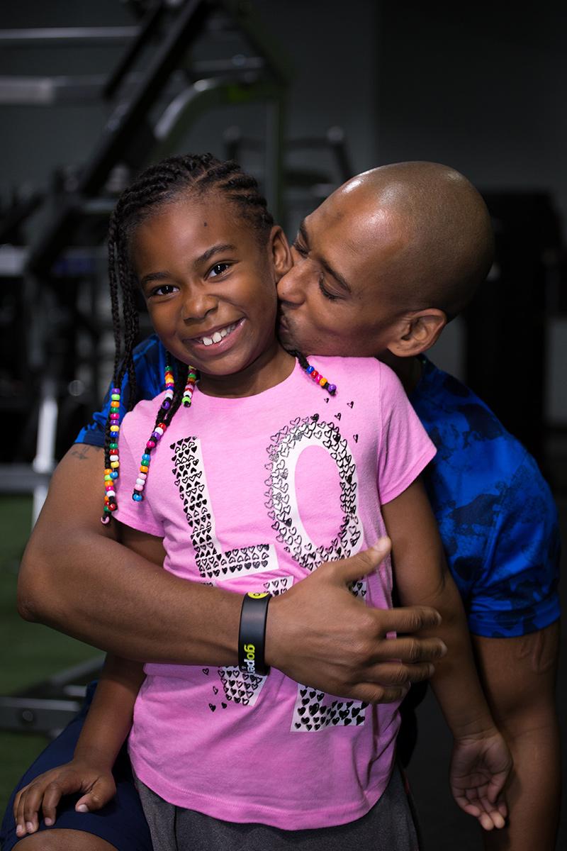 Coach-Louis-Allen-with-daughter.jpg