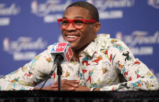 Russell Westbrook wears one of his statement shirts during a post-game interview