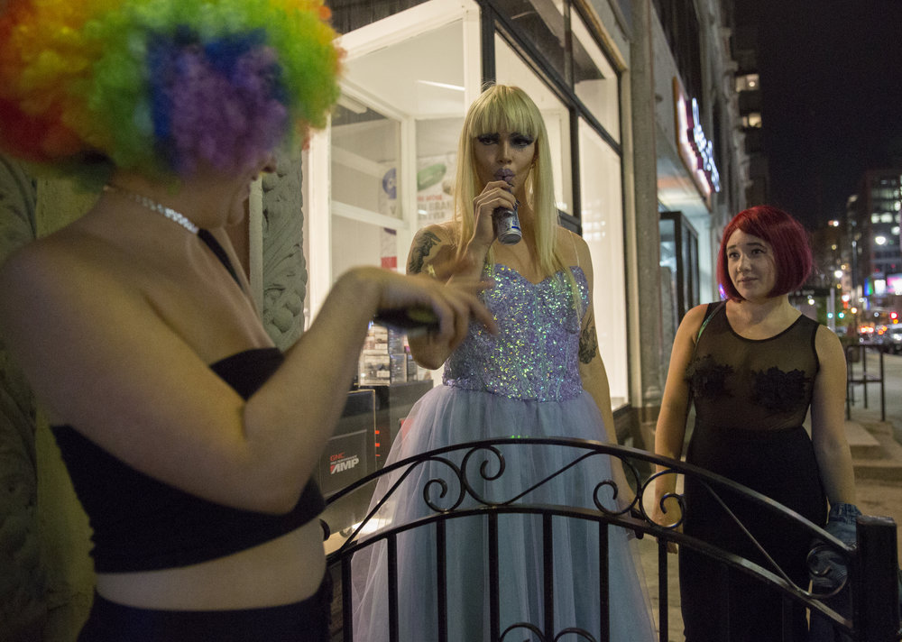 Rather than socialize with the other drag queens in the club's dressing room, Ophelia opts for a moment outside with friends Tori Baisden, 22, left, and Hannah Lifshutz, 23. She opts to sip on a Red Bull rather than an alcoholic beverage after a recent decision to live a sober lifestyle.