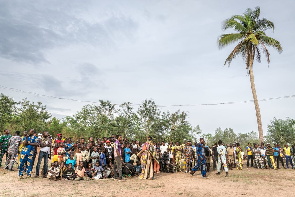 People gather to attend a Nago Voodoo ritual in the province of Zinvié, a town and arrondissement in the Atlantique Département of southern Benin.
