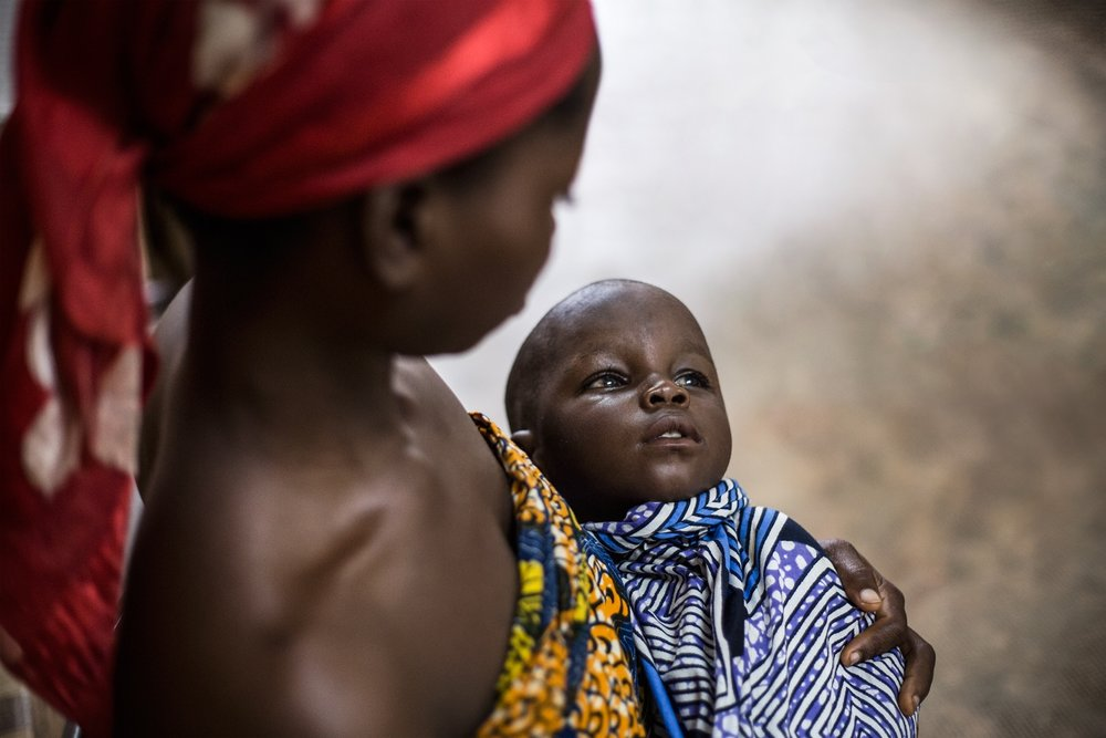 A young mother is waiting for her son to be checked by an ophthalmologist at the Gbemontin Centre. The diagnosis and treatment of the diseases of ophthalmological relevance constitute a serious priority emergency in Benin because of the lack of specialists and the high costs of the medical branch itself. Therefore this is the main reason why blindness is widespread even in young age.