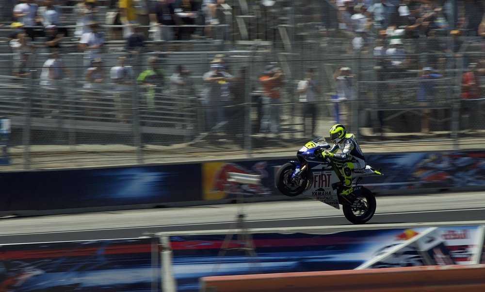 Rossi wheelie happy to get 4th.