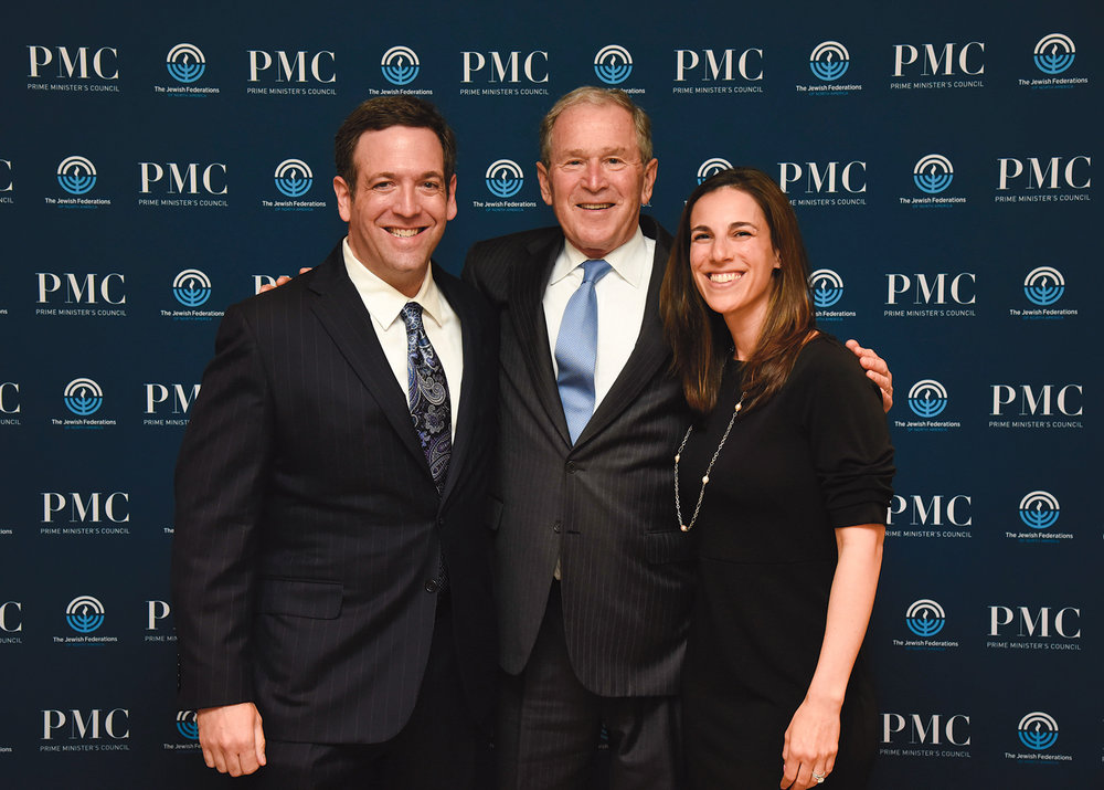 Adam and Phil Loewy with President George W. Bush at the President Bush Keynote Speaker at Prime Minister's Council event for Jewish Federations of North America, on March 21, 2018 in Fort Lauderdale, Florida. (JFNA Marketing)