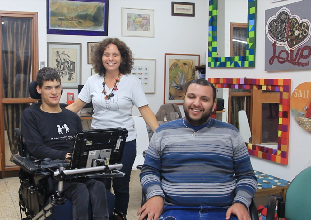 Tommy (left) with staff and participant of Shop for Meaning, a store that sells environmentally-friendly souvenirs and a vocational training center for young adults with disabilities in the fields of sales and tourism.  Photo credit: Wendy Goodman