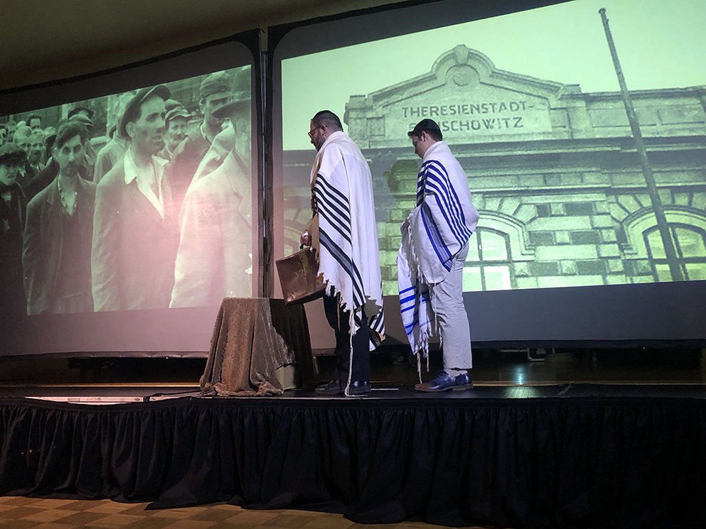 On-stage reenactment by Rabbi Neil Blumofe and Emet Blumofe. Credit: Wendy R. Corn