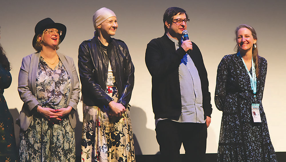 """Members of the cast and crew of """"It Started as a Joke"""" stood on stage with Eugene Mirman (center right) and his wife Katie Westfall Tharp (center left) while he answers questions from the audience following the screening of the documentary at Zach Theatre March 10. Credit: Wendy Goodman"""