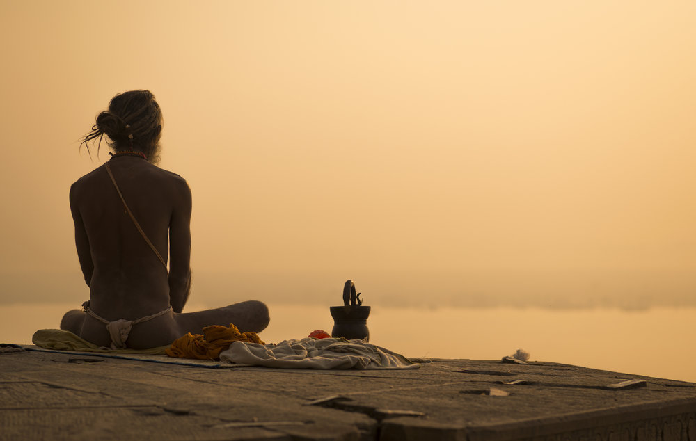 Yogi on the banks of the Ganges River in Varanasi, India