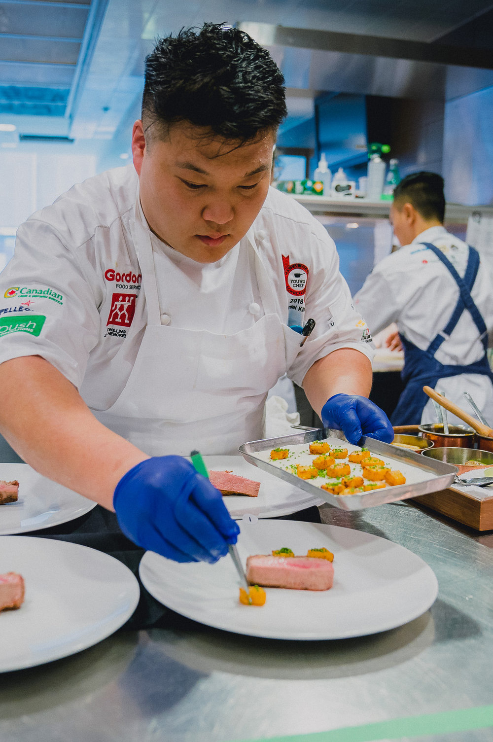 BOULEVARD KITCHEN'S DANIEL KIM WINS 2018 HAWKSWORTH YOUNG CHEF SCHOLARSHIP NATIONAL FINALS - October 15, 2018For the second year in a row, a key member of the Boulevard Kitchen & Oyster Bar back-of-house team won the Hawksworth Young Chef Scholarship finals in Toronto as Junior Sous Chef Daniel Kim reigned supreme at the annual culinary competition this past weekend.The national competition involved a black-box challenge during which the eight finalists had three hours to incorporate such mystery ingredients as Fraser Valley Specialty Poultry duck, guanciale sorrentino, butternut squash, local honey, Canadian eggs and Cacao Barry Origin Saint-Domingue 70% Dark Chocolate into a main dish and dessert course. An all-star culinary panel of 13 top chefs and critics including David Hawksworth, Norman Laprise, Lee Cooper, Jacob Richler and Lian Yeung judged the final dishes.