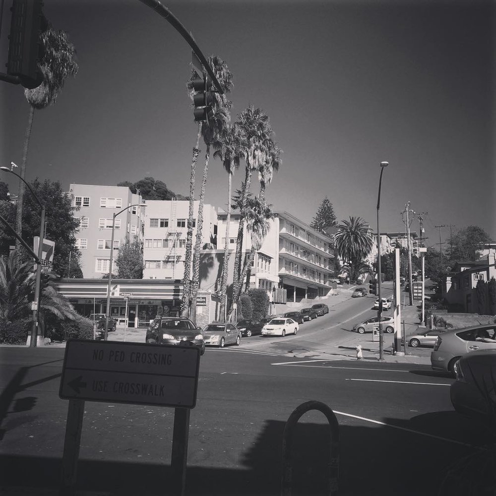 Feel like I'm in a movie! #oakland #calilife #seveneleven #grandave #palmtrees #bored #okimdone