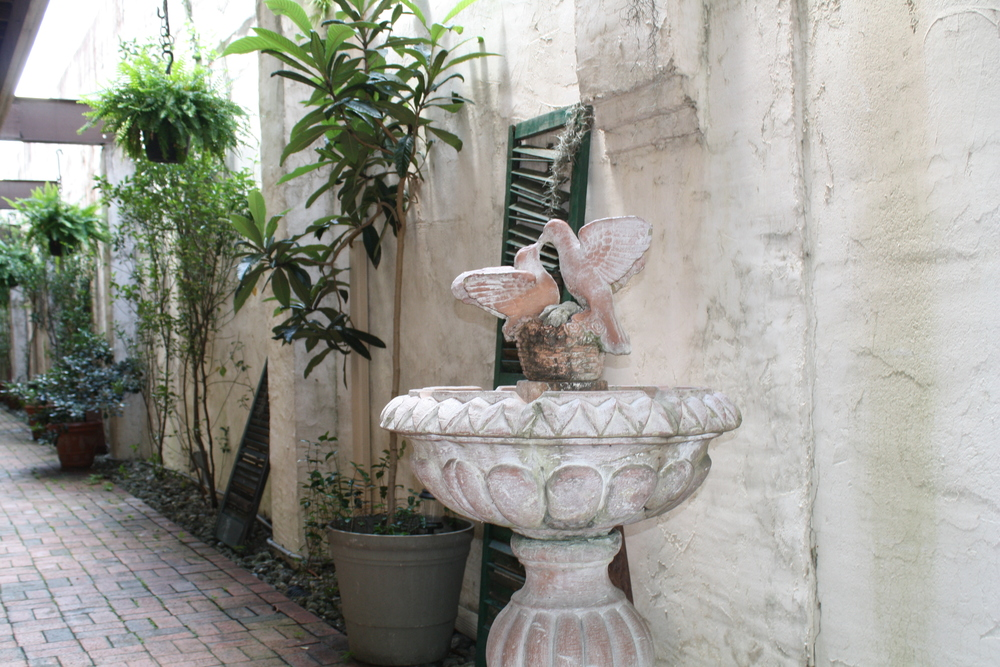 This birdbath was at an entry to what are now apartment buildings, formerly the mercantile shop.