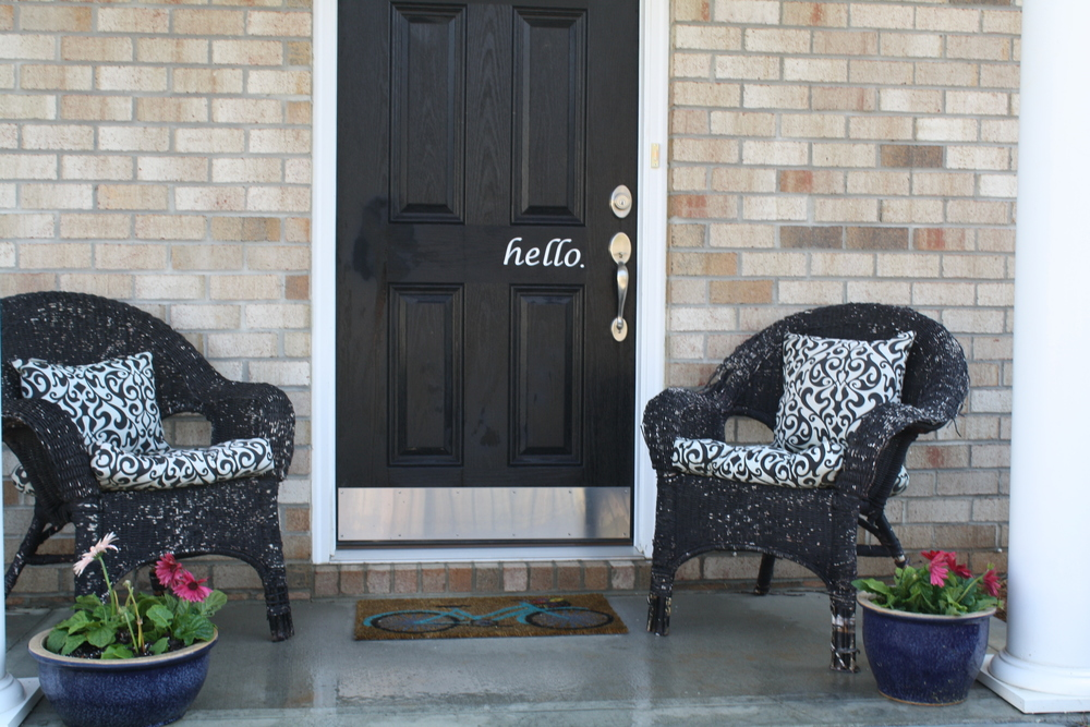 "This is our front porch; I found the ""hello"" decal on Amazon, I've been thinking a ""goodbye"" in black on the white inside of the door would be cute!"