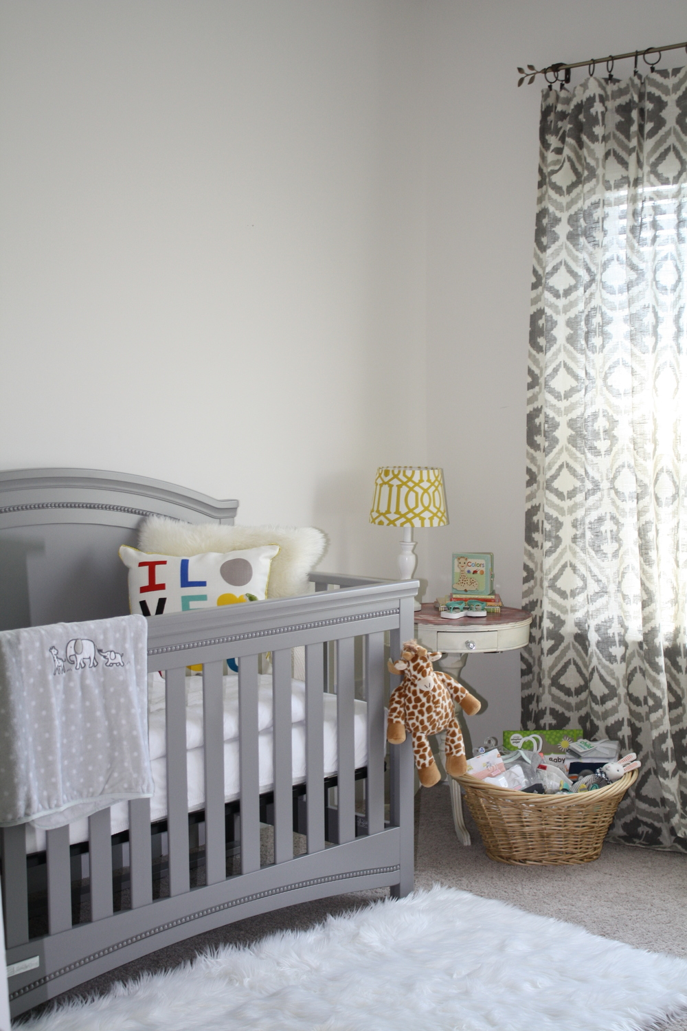 ...and heeeerrrre's the nursery! Or a little corner of it, anyway. We still need to get the glider (my mom is buying it and hasn't had a chance to come down yet) but at least we have a crib, dresser/changing table and a white furry rug. #priorities