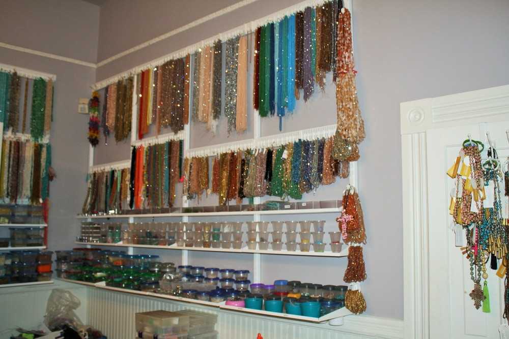Thousands of beads hang in the workroom, ready for creative hands to make something beautiful.