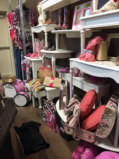 Look at all the pink in this picture! Pillows, a pouf, scarves, loafers and a DRUM SET!
