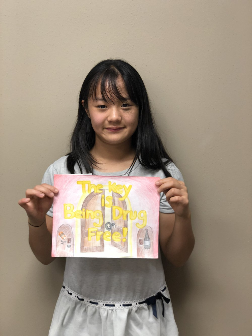 "Joy Ting - Joy Ting is in the 8th grade and her picture features a key and a ""drug free"" rhyme. Joy has played tennis for three years. She also enjoys arts and crafts in her spare time. Joy has a younger brother and sister and enjoys snorkeling."