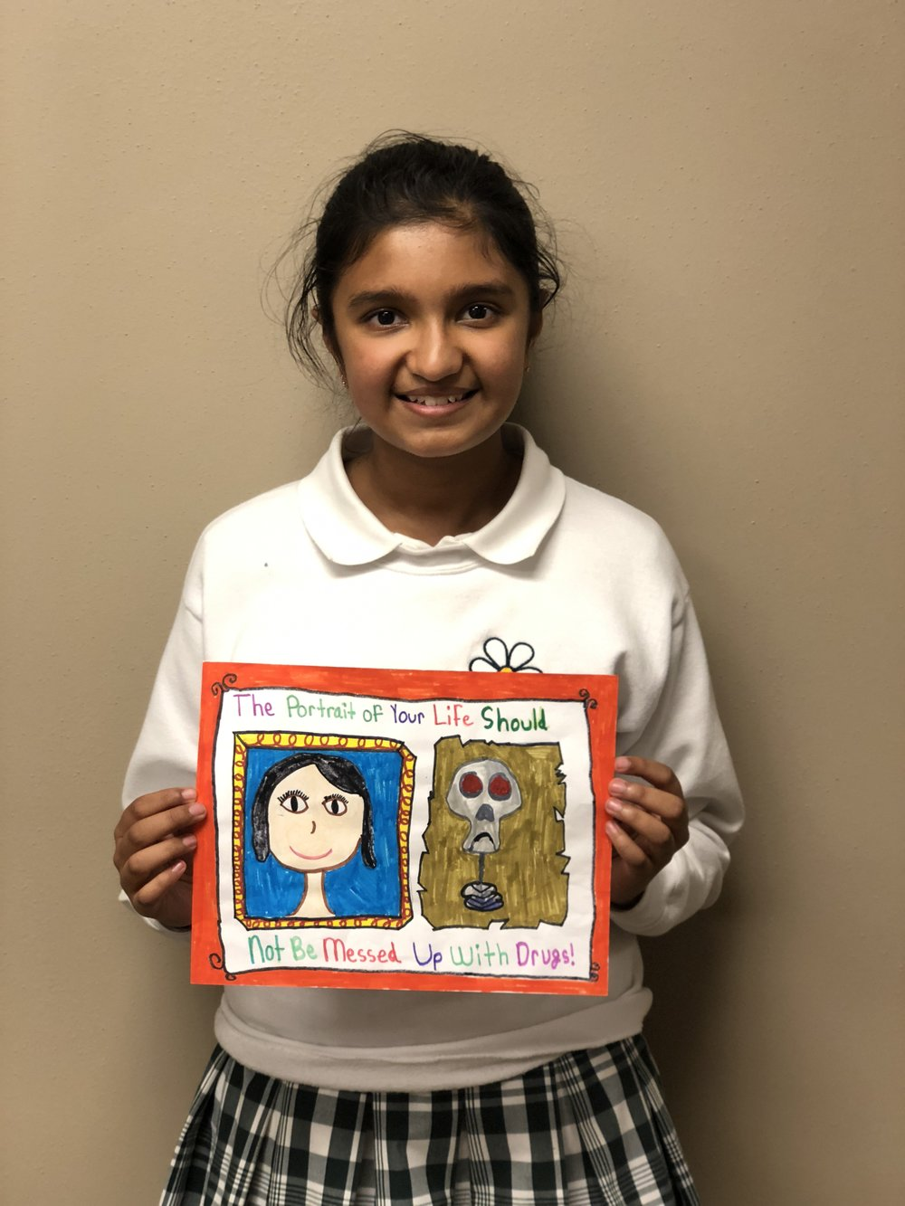 "Anya Ahuja - Anya Ahuja is a 5th grader and her artwork represents a ""portrait"" of what someone looks like doing drugs and not doing drugs.  She enjoys the violin, math, golf, and reading in her spare time.  She also likes to play with Wonder, her Havanese-Maltese puppy."