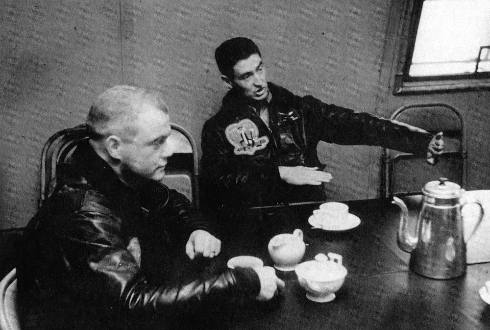 Major John Glenn (L) and Captain Ted Williams discussing aerial maneuvers while drinking their morning coffee at K-3 Air Force Base in South Korea, 1953. (Thanks to Bill Nowlin, author of  Ted Williams at War , for providing this photo. You can check out his book  here .)