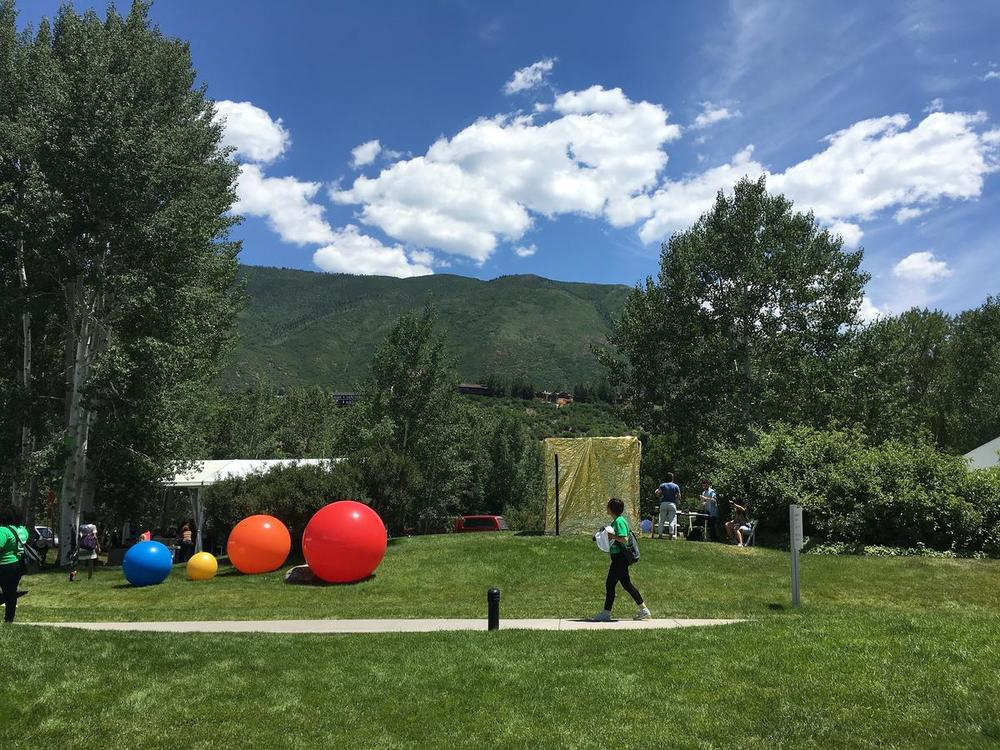 The gold-lamé covered portal sits at the Aspen Institute this week. CREDIT ALYCIN BEKTESH / ASPEN PUBLIC RADIO
