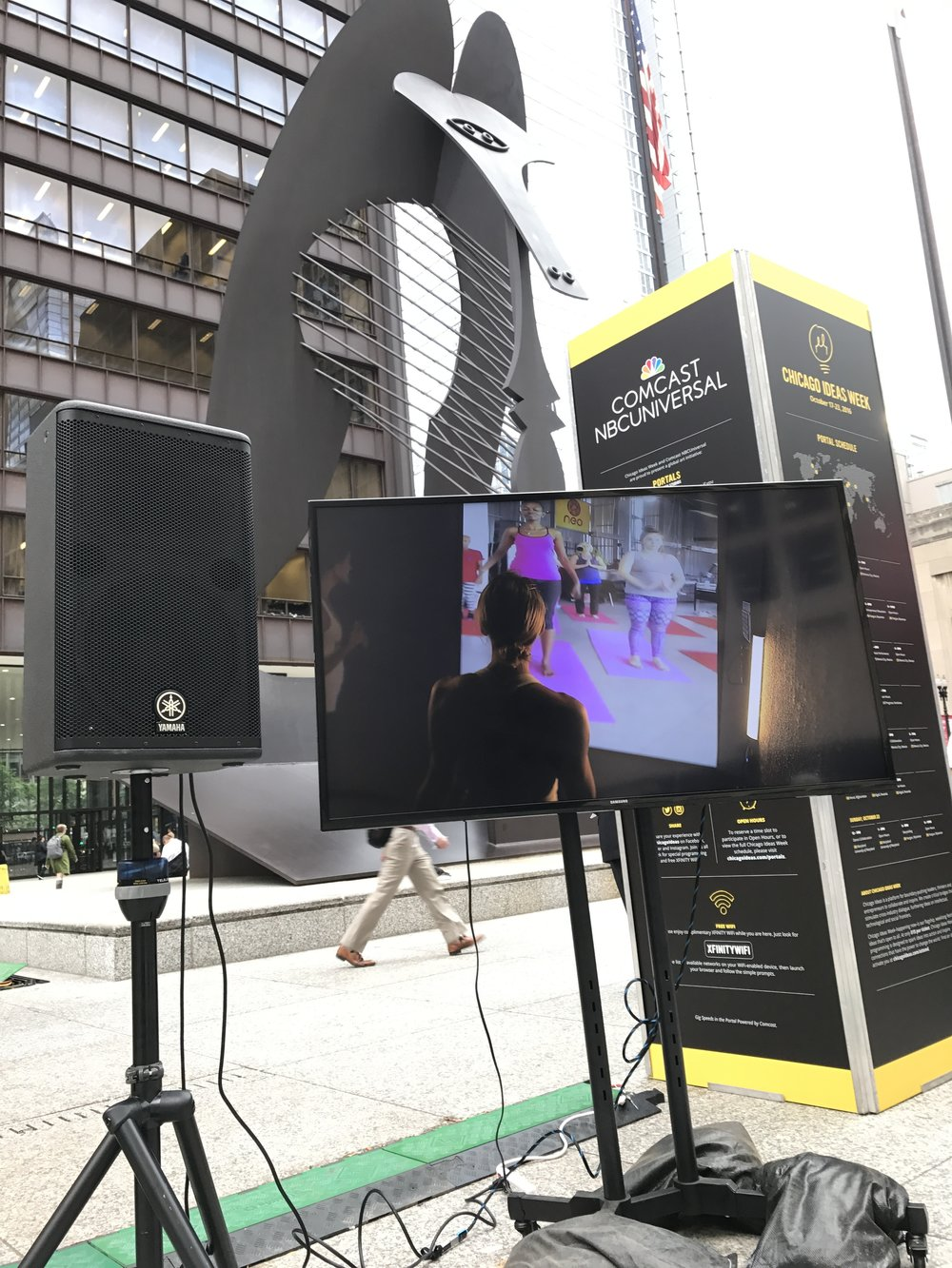 Live stream of a yoga class from Kigali outside the Chicago Portal