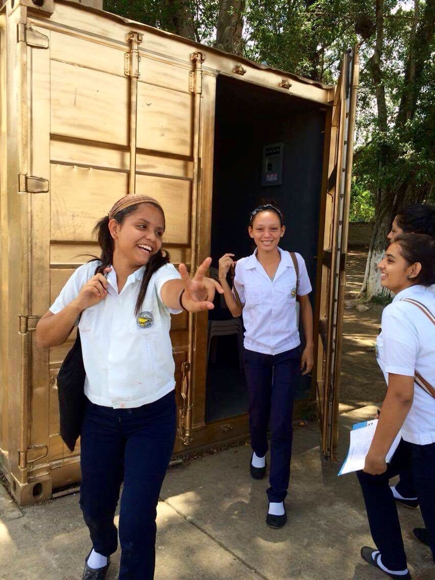 High school students in El Progreso, Honduras outside their Portal
