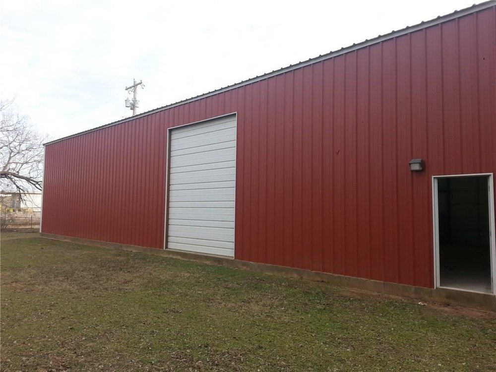 The back of the barn. We will glass in the large door and have so much space outside for activities and concerts!